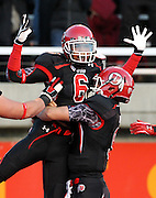 Utah wide receiver Dres Anderson (6) celebrates with quarterback Jon Hays (9) after catching a pass for a touchdown against Oregon State during the first half of an NCAA college football game at Rice-Eccles Stadium, Saturday, Oct. 29, 2011, in Salt Lake City.  (AP Photo/Colin E. Braley).