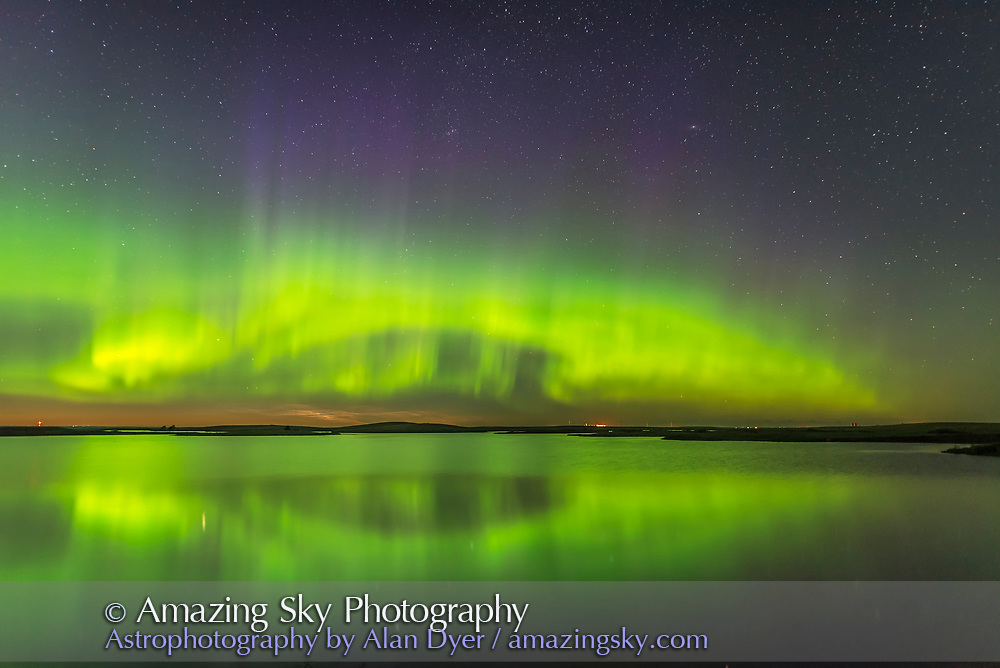 The Northern Lights and a faint display of noctilucent clouds (low on the horizon) over the waters of Crawling Lake in southern Alberta, on June 24/25, 2017.<br /> <br /> A single exposure taken as part of a time-lapse sequence with the 20mm lens and Nikon D750.