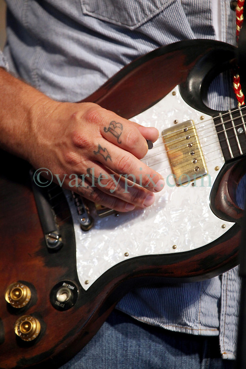 27 April 2012. New Orleans, Louisiana,  USA. .New Orleans Jazz and Heritage Festival. .Eric Lindell plays his guitar to the Blues tent. .Photo; Charlie Varley.