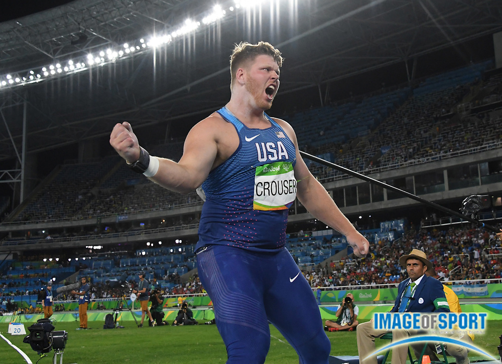 Aug 18, 2016; Rio de Janeiro, Brazil; Ryan Crouser (USA) celebrates after winning the shot put in an Olympic record 73-10¾ (22.52m) during the 2016 Rio Olympics at Estadio Olimpico Joao Havelange.