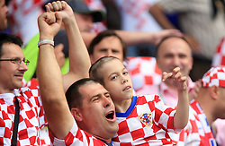 Man from Croatia and his ill son celebrating a goal during the UEFA EURO 2008 Group B soccer match between Austria and Croatia at Ernst-Happel Stadium, on June 8,2008, in Vienna, Austria.  (Photo by Vid Ponikvar / Sportal Images)