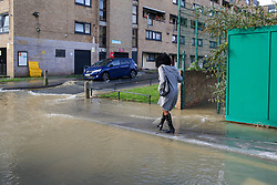 © Licensed to London News Pictures. 08/10/2019. London, UK. Local housing estate is flooded following a burst water main on Brownswood Road in Finsbury Park, north London. Emergency services and Thames Water are at the scene.  Photo credit: Dinendra Haria/LNP