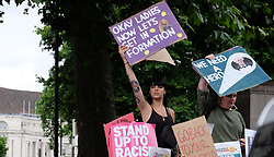 June 24, 2017 - London, United Kingdom - Protestors hold banners as they rally outside Downing street, in London, on June 24, 2017. Hundreds of people gather outside Downing street to protest against the Conservative party, DUP coalition government. (Credit Image: © Jay Shaw Baker/NurPhoto via ZUMA Press)