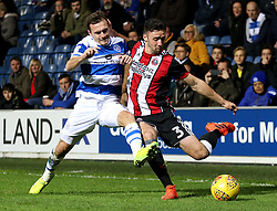 Sheffield United's Enda Stevens and Queens Park Rangers' Josh Scowen in action during the game during the Sky Bet Championship match at Loftus Road, London.