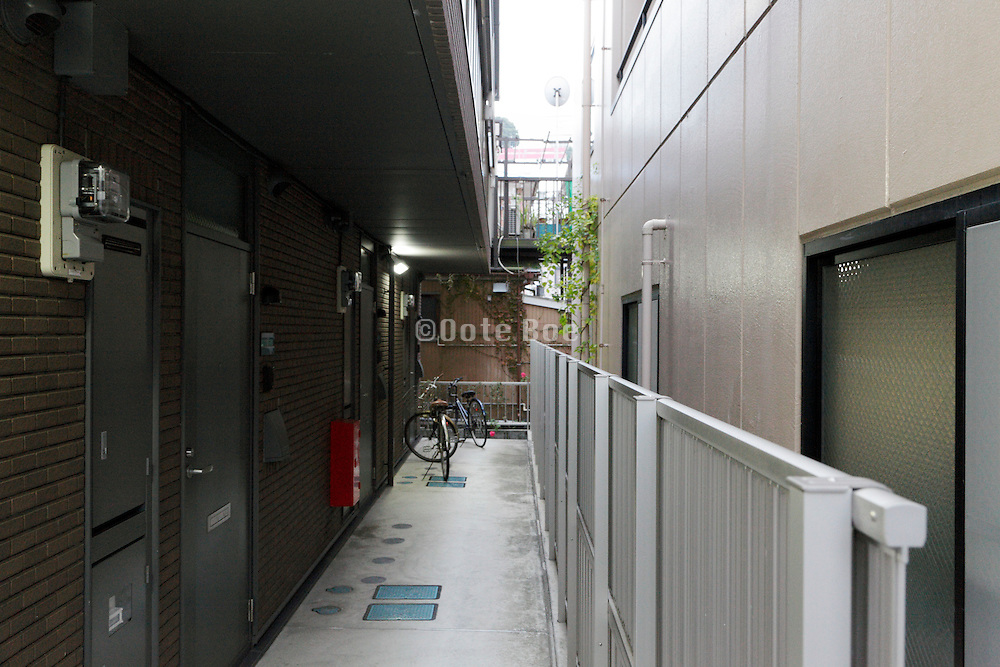 pathway with student housing front entree doors Japan