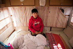 © London News Pictures. 29/04/2016. Calais, France. 11 year-old Unaccompanied child refugee Afghan boy Zyrat  inside the caravan he lives in at the calais Jungle. David Cameron has announced Britain will take in some child refugees living in camps inside the EU. Photo credit: Ben Cawthra/LNP