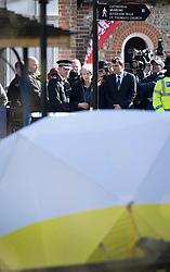 © Licensed to London News Pictures. 15/03/2018. Salisbury, UK. British Prime Minister THERESA MAY (C) stands with Chief Constable Kier Pritchard as she looks at the police evidence tent that covers the spot at The Maltings shopping area in Salisbury, Wiltshire where Former Russian spy Sergei Skripal and his daughter Yulia were found after being poisoned with nerve agent. The couple where found unconscious on bench in Salisbury shopping centre. A policeman who went to their aid is currently recovering in hospital. Photo credit: Peter Macdiarmid/LNP