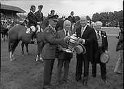 Aga Khan Trophy..1979..10.08.1979..08.10.1979..10th August 1979..The annual staging of the Aga Khan Cup took place  at the Royal Dublin Showgrounds, Ballsbridge,Dublin today.It was the first time since 1937 that Ireland won the trophy outright. The winning Irish team comprised of Paul Darragh,Capt Con Power,James Kernan and Eddie Macken..President, Dr Patrick Hillery, is pictured presenting Col Ringrose with the Aga Khan Cup after the Irish team's great achievement in winning the cup outright for the first time since 1937. In the centre of the picture is Col Dan Corry who was a member of the Irish team in 1937.