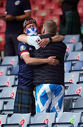 Scotland fans embrace ahead of the UEFA Euro 2020 Group D match at Hampden Park, Glasgow. Picture date: Monday June 14, 2021.