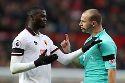 Watford's M'Baye Niang (left) is lectured by referee Robert Madley