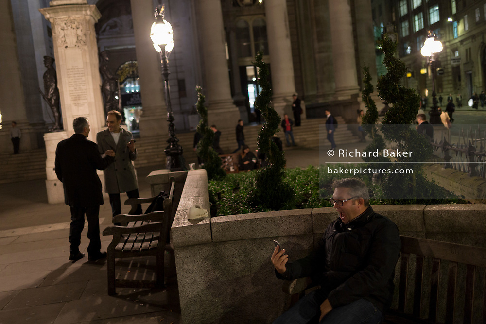 A man pulls faces during a live stream with family amid the bustle of Cornhill, in the Square Mile, the heart of the capital's historical financial district, on 2nd October 2017, in the City of London, England.
