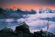 Sunset on Chomolungma, Mt Everest, ( Makalu in distance) - prayer flags on Gokyo Ri., Khumbu Himal, Nepal.