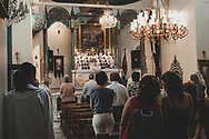 Christians worship inside an Armenian church in the old city of Damascus, Syria, on a Sunday morning.  (June 6, 2010)