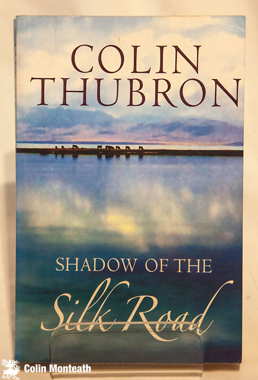 SHADOW ON THE SILK ROAD,  Colin Thubron, Chatto & Windus, London, 2006, 363 page softbound, maps, a remarkable travelogue across the face of Asia following one of the Silk roads from Xian, China to Aleppo Syria - as always, astute Thubron observations - $28 (Arnold Heine Collection)