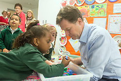 © Licensed to London News Pictures. 01/05/2014. Surbiton, UK. Nick Clegg takes part in a phonics project.  Deputy Prime Minister Nick Clegg visits Lime Tree Primary School in Surbiton today 1st May 2014. Whilst there he took part in a painting, phonics and maths projects with school children. Photo credit : Stephen Simpson/LNP