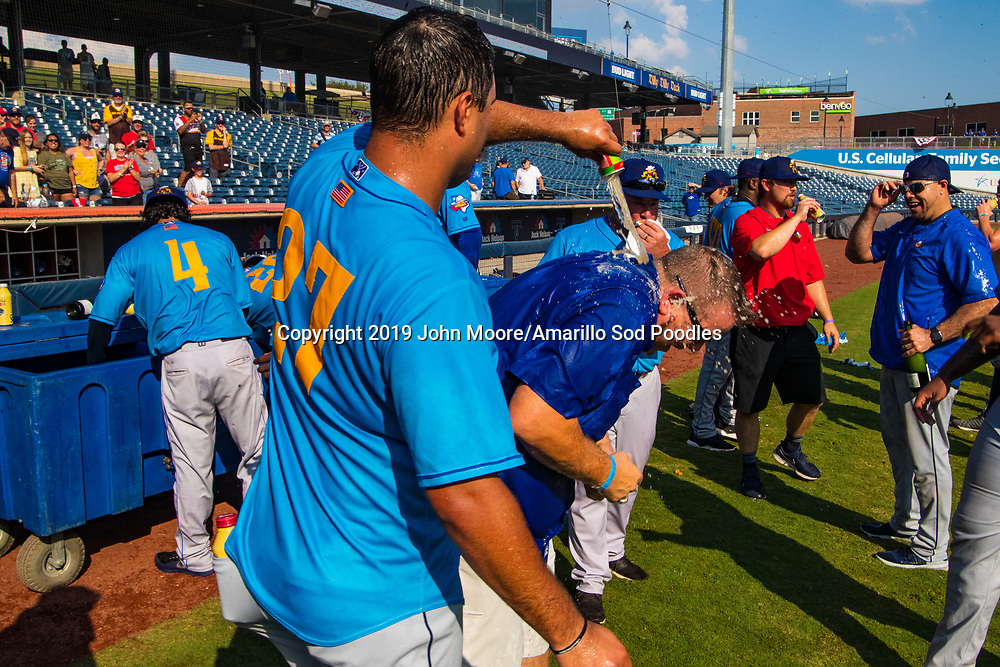 Amarillo Sod Poodles pitcher Travis Radke (27) and Tony Ensor  celebrates after the Sod Poodles won against the Tulsa Drillers during the Texas League Championship on Sunday, Sept. 15, 2019, at OneOK Field in Tulsa, Oklahoma. [Photo by John Moore/Amarillo Sod Poodles]