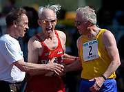 Mel Larson (center) is congratulated by Edward Cox (right) after winning the Masters men age 75-and-over 100 meters in the 110th Penn Relays at  Franklin Field on Saturday, April 24, 2004 in Philadelphia.