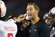 DALLAS, TX - AUGUST 30: Head coach Kliff Kingsbury of the Texas Tech Red Raiders has words with his team against the SMU Mustangs on August 30, 2013 at Gerald J. Ford Stadium in Dallas, Texas.  (Photo by Cooper Neill/Getty Images) *** Local Caption *** Kliff Kingsbury