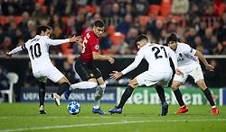 Manchester United's Andreas Pereira (centre) battles for the ball with Valencia's Dani Parejo (left) and Cristiano Piccini