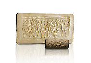 Hittite cylinder seal depicting a scene of animals, seal in foreground and impression standing behind.. Adana Archaeology Museum, Turkey. Against a white background .<br /> If you prefer to buy from our ALAMY STOCK LIBRARY page at https://www.alamy.com/portfolio/paul-williams-funkystock/hittite-art-antiquities.html . Type - Adana - in LOWER SEARCH WITHIN GALLERY box. Refine search by adding background colour, place, museum etc<br /> <br /> Visit our HITTITE PHOTO COLLECTIONS for more photos to download or buy as wall art prints https://funkystock.photoshelter.com/gallery-collection/The-Hittites-Art-Artefacts-Antiquities-Historic-Sites-Pictures-Images-of/C0000NUBSMhSc3Oo