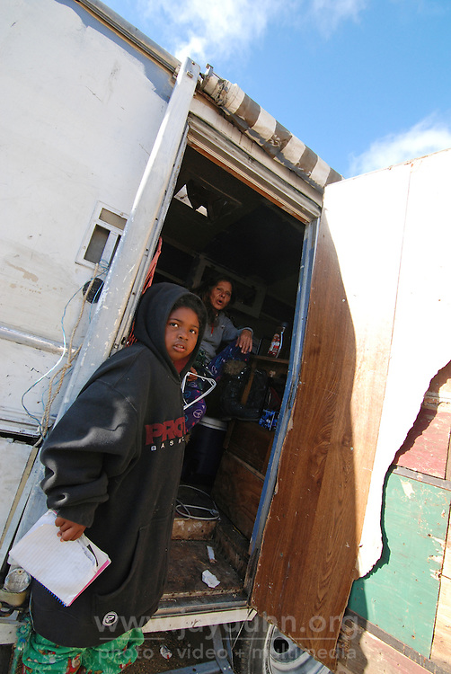 A child takes temporary refuge from this morning's eviction at Diana Soto's RV.