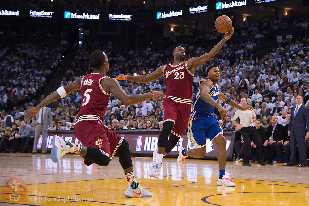 December 25, 2015; Oakland, CA, USA; Cleveland Cavaliers forward LeBron James (23) steals the basketball during the third quarter in a NBA basketball game on Christmas against the Golden State Warriors at Oracle Arena. The Warriors defeated the Cavaliers 89-83.