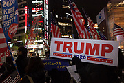 """A Japanese man, holds a sign reading Trump- 2020 as several hundred people, taking part in a """"March For Trump"""" rally  in support of the out-going United States President, Donald Trump. Tokyo, Japan. Wednesday January 6th 2021. The rally of mostly Japanese people took place as part of a similar rally by Trump-supporters in Washington DC as the results of the 2020 US Presidential election were confirmed."""