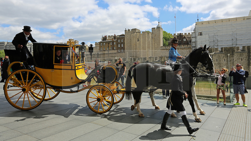 © Licensed to London News Pictures. 21/06/2015.  London. The New Waterlook Despatches seen crossing Tower Bridge before arriving at a ceremony at Tower of London where they were greeted by a Flemmish band. The horse drawn carriage with the despatches re-enacts the return of news of victory at Waterloo 200 years ago . Credit : Rob Powell/LNP