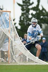28 March 2009: North Carolina Tar Heels midfielder Sean Burke (42) with a goal during a 10-9 overtime win over the Johns Hopkins Blue Jays on Fetzer Field in Chapel Hill, NC.