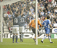 Photo: Aidan Ellis.<br /> Wigan Athletic v Newcastle United. The Barclays Premiership. 15/10/2005.<br /> Newcastle's Michael Owen and Shola Ameobi claim alan Shearer's header crossed the line of the bar