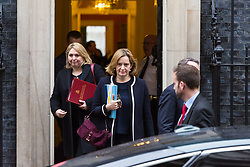 London - Home Secretary Amber Rudd and Secretary of State for Northern Ireland Karen Bradley leave the weekly meeting of the UK cabinet at Downing Street. January 23 2018.