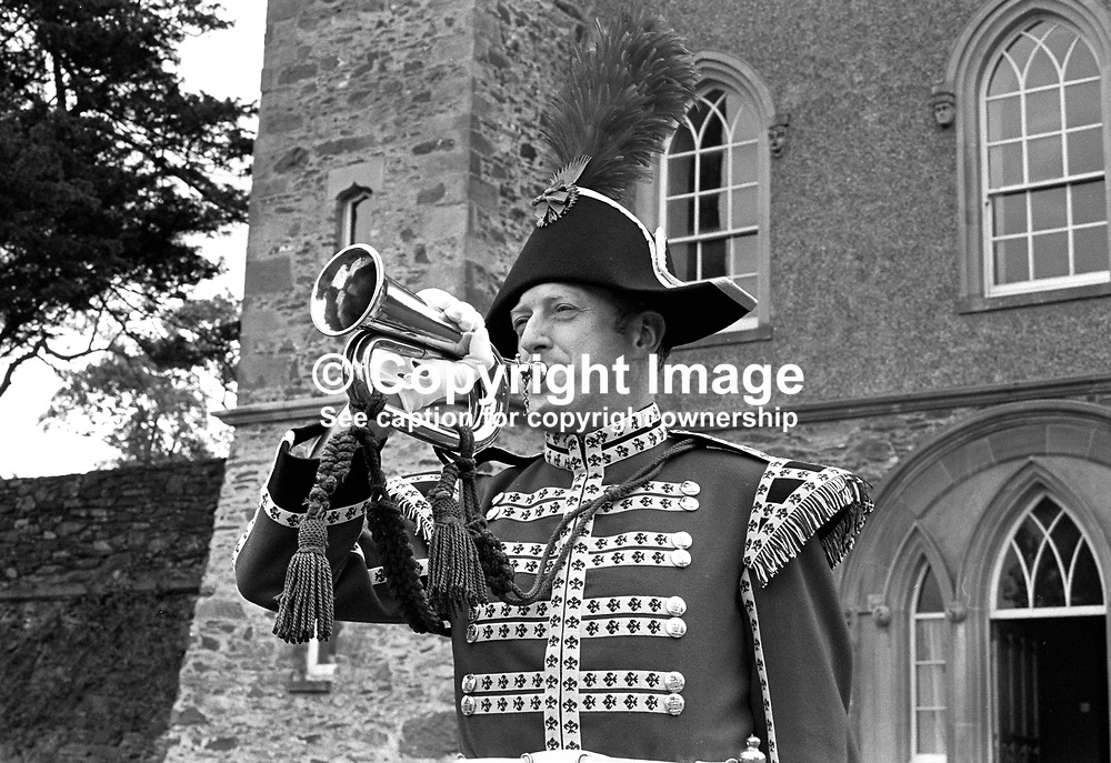 Bugler Gerald Silcock, the only member of the Hillsborough Guard, on the occasion of his commissioning by the Marquis of Downshire. The ceremony took place at the Old Fort near the centre of the village in N Ireland, UK. 19713220257c.<br /> <br /> Copyright Image from Victor Patterson, Belfast, UK<br /> <br /> t: +44 28 9066 1296 (from Rep of Ireland 048 9066 1296)<br /> m: +44 7802 353836<br /> e: victorpattersonbelfast@gmail.com<br /> <br /> www.images4media.com<br /> <br /> Please see my full Terms and Conditions of Use at https://www.images4media.com/p/terms-conditions - it is IMPORTANT that you familiarise yourself with them.<br /> <br /> Images used online incur an additional cost. This cost should be agreed in writing in advance. Online images must be visibly watermarked i.e. © Victor Patterson or that of the named photographer within the body of the image. The original metadata must not be deleted from images used online.<br /> <br /> This image is only available for the use of the download recipient i.e. television station, newspaper, magazine, book publisher, etc, and must not be passed on to a third party. It is also downloaded on condition that each and every usage is notified within 7 days to victorpattersonbelfast@gmail.com.<br /> <br /> The right of Victor Patterson (or the named photographer) to be identified as the author is asserted in accordance with The Copyright Designs And Patents Act (1988). All moral rights are asserted.