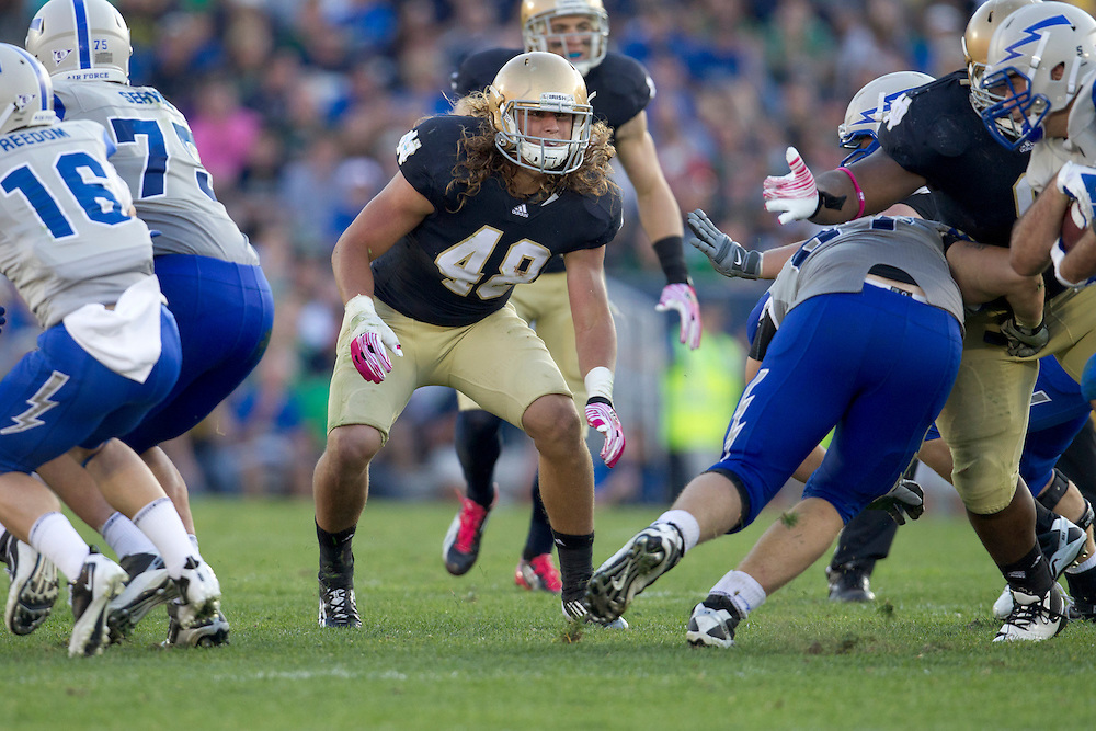 Notre Dame outside linebacker Dan Fox (#48) pursues the ball carrier  in action during NCAA football game between Notre Dame and Air Force.  The Notre Dame Fighting Irish defeated the Air Force Falcons 59-33 in game at Notre Dame Stadium in South Bend, Indiana.