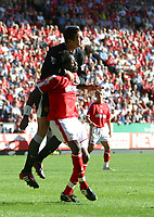 Photo: Jo Caird<br />Charlton v Manchester United at The Valley.<br />13/09/2003.<br />Roy Keane climbs on Jason Euell