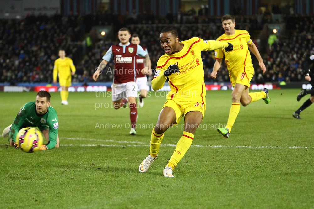 Raheem Sterling of Liverpool shoots and scores his teams 1st goal. Barclays Premier league match, Burnley v Liverpool at Turf Moor in Burnley, Lancs on Boxing Day, Friday 26th December 2014.<br /> pic by Chris Stading, Andrew Orchard sports photography.