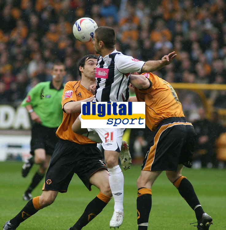 Photo: Mark Stephenson.<br /> Wolverhampton Wanderers v West Bromwich Albion. Coca Cola Championship. Play off Semi Final, 1st Leg. 13/05/2007.West Brom's Kevin Phillips wins the ball