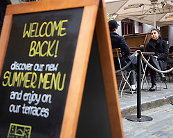 © Licensed to London News Pictures. 12/04/2021. London, UK. Members of the public eat out in a covered area of Covent garden in central London. From today restaurants will reopen with outdoor dining following the easing of lockdown restrictions. Photo credit: George Cracknell Wright/LNP
