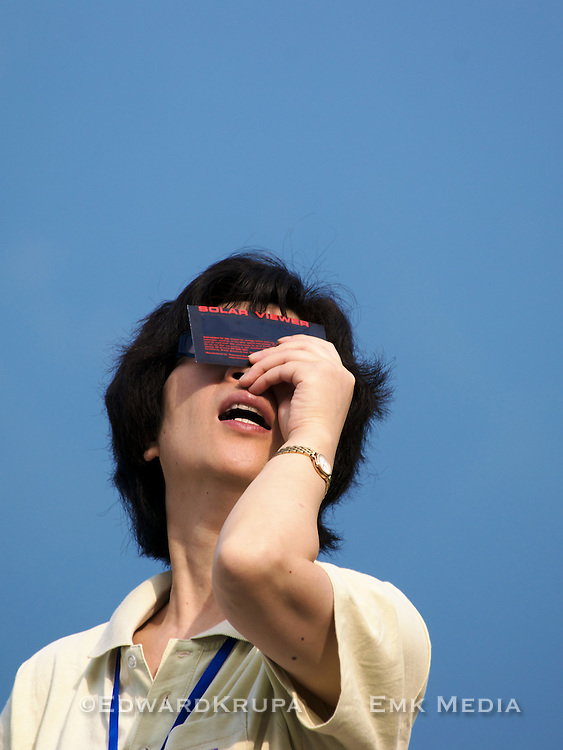 Watching the sun as the total solar eclipse approaches, Tianhuangping China.