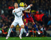 BARCELONA, SPAIN - NOVEMBER 29: Dani Alves of Barcelona and Cristiano Ronaldo of Real Madrid during the La Liga match between Barcelona and Real Madrid at the Camp Nou Stadium on November 29, 2010 in Barcelona, Spain. (Photo by Manuel Queimadelos/DPPI)