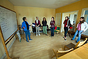 From 2008. Lois Arkin, founder of LA Eco-Village, talks to visitors in Community room.. Founded in 1993, LA Eco-Village demonstrates the processes for creating a healthy neighborhood ecologically, socially and economically and to reduce environmental impacts while raising the quality of neighborhood life.