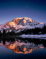 The Willis Wall of Mount Rainier's North Face and moon reflected in alpine tarn at Mystic Pass, Mount Rainier National park Washington USA