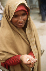Woman begging in street in India,