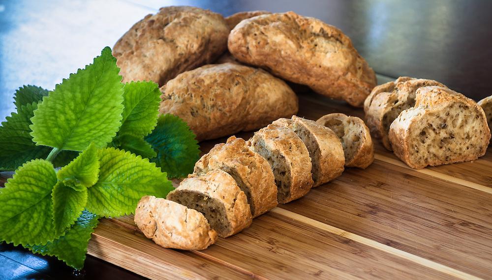 Gluten Free herb Bread sliced with fresh oregano garnish