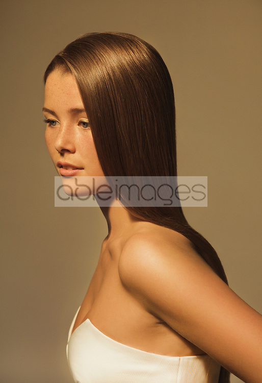 Side View of Young Woman with Glossy Straight Hair