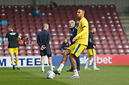 Wimbledon defender Terell Thomas (6) warming up during the EFL Sky Bet League 1 match between Scunthorpe United and AFC Wimbledon at Glanford Park, Scunthorpe, England on 30 March 2019.