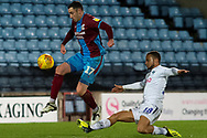 Scunthorpe United forward Lee Novak (17) jumps over Wycombe Wanderers midfielder Curtis Thompson (18) during the EFL Sky Bet League 1 match between Scunthorpe United and Wycombe Wanderers at Glanford Park, Scunthorpe, England on 29 December 2018.