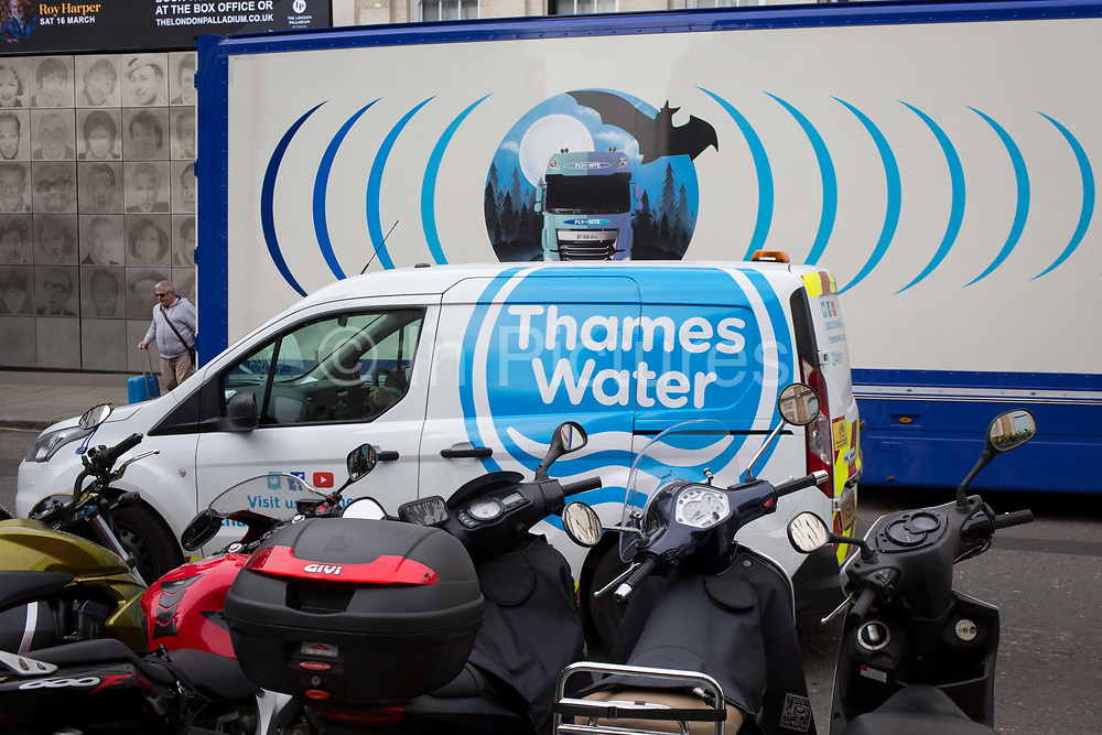The design on the side of an HGV for the rehearsal studio company Fly By Nite and a Thames Water van in Great Marlborough Street, on 5th March 2019, in London, England.