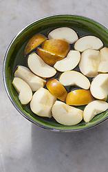 Apples in bowl of water