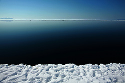 The ice edge near Siorapaluk, Greenland. A changing climate - which shows itself in warming temperatures, earlier summers, later winters, and shrinking and thinning sea ice - threatens the livelihoods and traditions of some of the last subsistence hunters on Earth, the Polar Inuit communities of far Northwest Greenland.