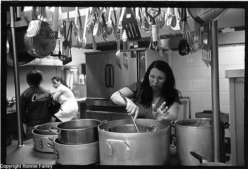 United Houma Chief Brenda Dardar-Robichaux is seen cooling sauce to be used for the Houma concession stand at the New Orleans Jazz Fest,La Rosa Community Center, Lafourche Parish, Louisiana, 2008